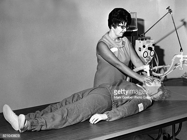 Woman with breathing equipment dummy late 1960s