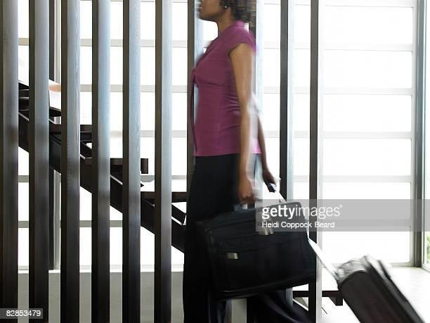 woman with briefcase - heidi coppock beard stock-fotos und bilder