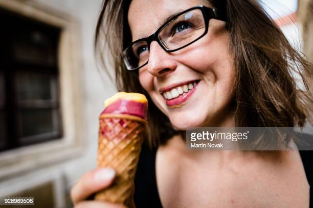 Woman with bright smile having an ice cream