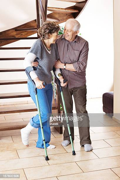 woman with broken leg and crutches - izusek stock pictures, royalty-free photos & images