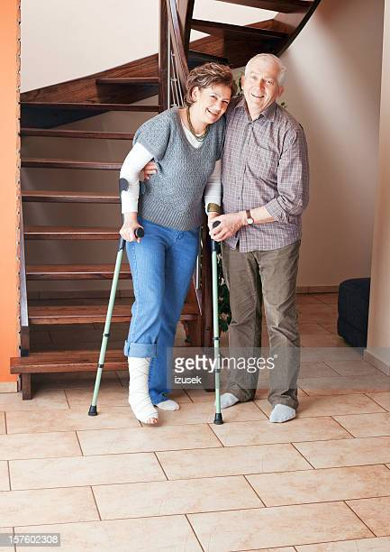 Woman with broken leg and crutches