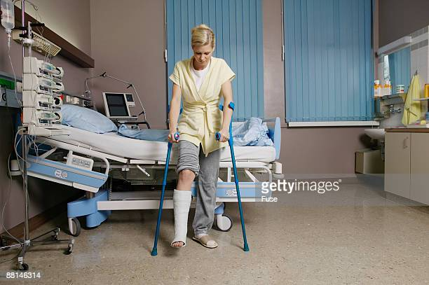 Woman with Broken Leg Using Crutches