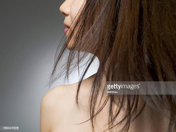 Woman with brown-dyed hair who turns to width