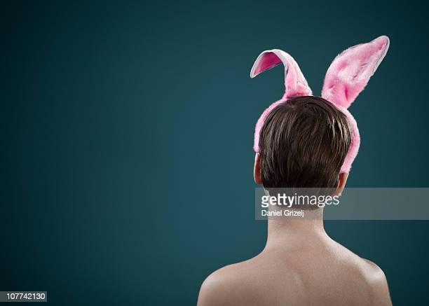 Woman with bunny ears