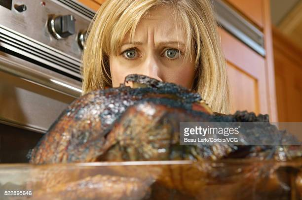 woman with burnt turkey - funny turkey images stock photos and pictures