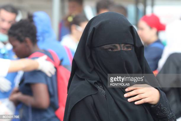 PORT PALERMO SICILY ITALY A woman with burqa during the landing by ship Vos Prudence in Palermo Sicily southern Italy 877 migrants landed including...