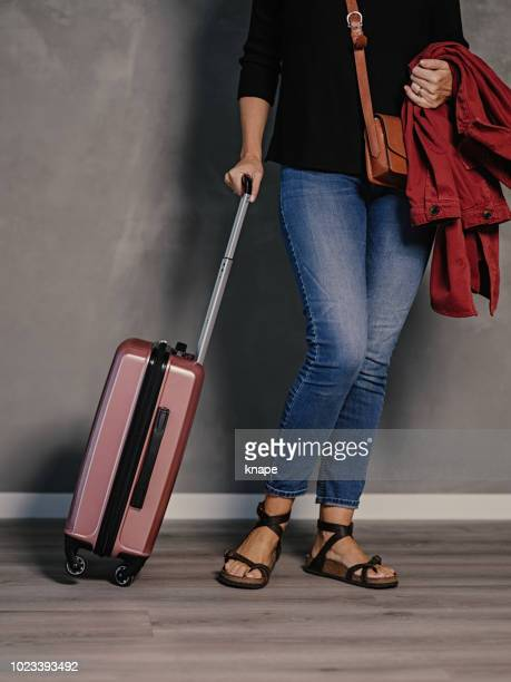 woman with cabin suitcase/carry-on luggage ready to travel - wheeled luggage stock photos and pictures