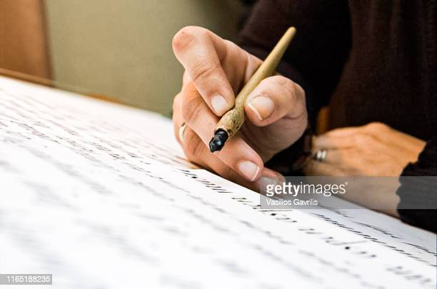 woman with calligraphy materials on table - close to stock pictures, royalty-free photos & images