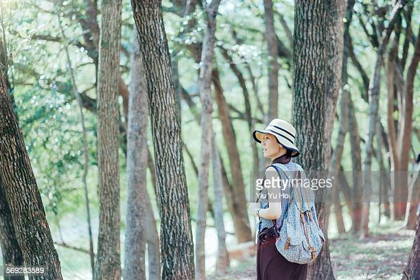 woman with camera is exploring around in nature - yiu yu hoi stock pictures, royalty-free photos & images