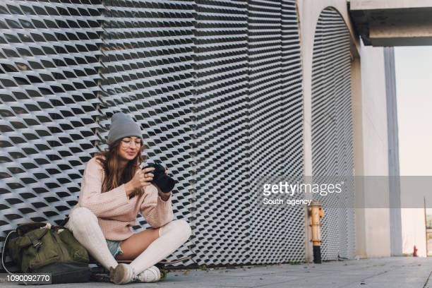 woman with camera - knee length stock pictures, royalty-free photos & images