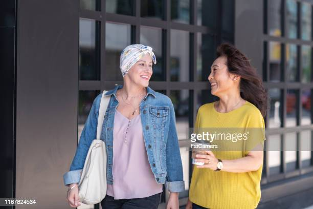 woman with cancer enjoys precious time with a friend - survival stock pictures, royalty-free photos & images