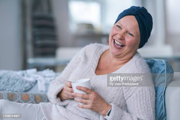 woman with cancer laughing - chemotherapy drug stock pictures, royalty-free photos & images