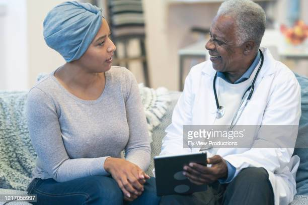 woman with cancer talking with doctor - leukemia stock pictures, royalty-free photos & images