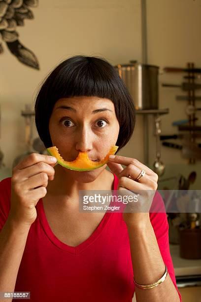 woman with cantaloupe melon smile