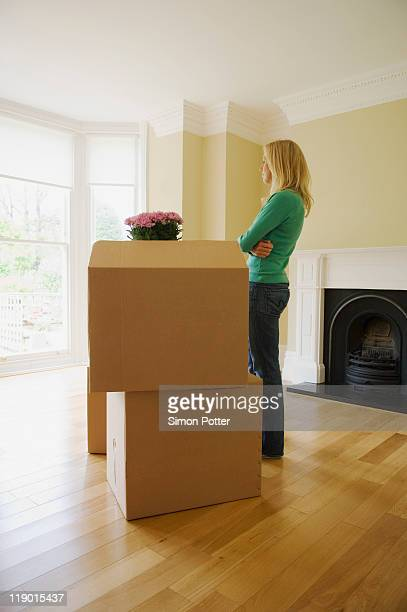 Woman with cardboard boxes in new home