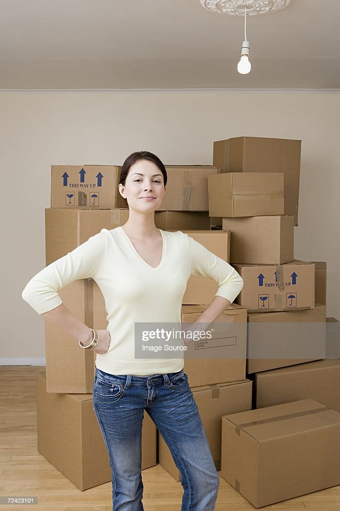 Woman with cardboard boxes : Stock Photo