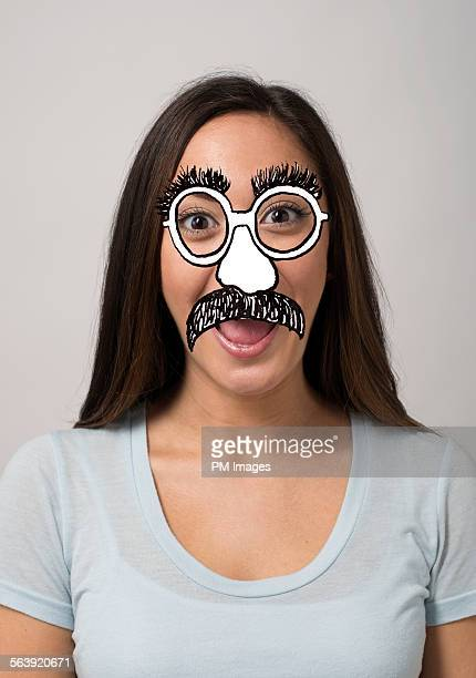 woman with cartoon disguise - long nose stock photos and pictures