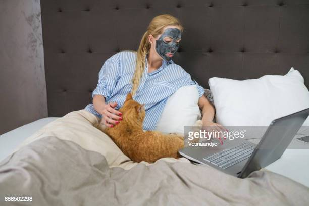 Woman with cat at bed