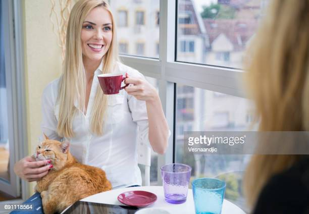 Woman with cat at cafe