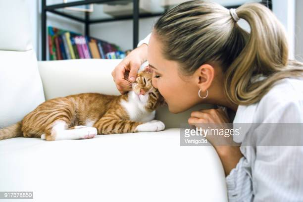 Woman with cat at home