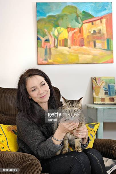 Woman with cat in living room