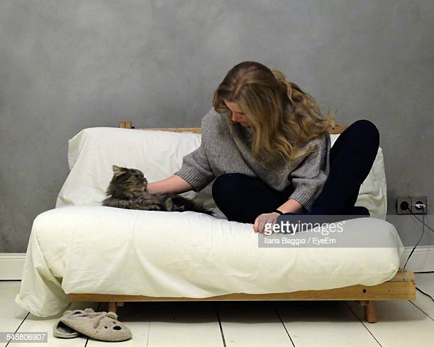 Woman With Cat On Sofa