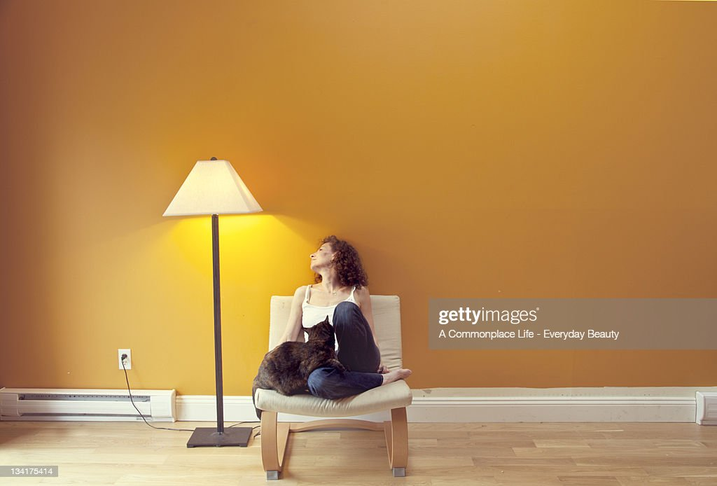 Woman with cat : Stockfoto