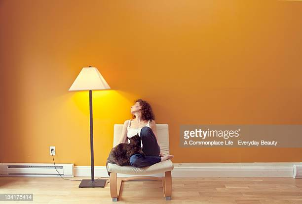 woman with cat - lamp stock-fotos und bilder