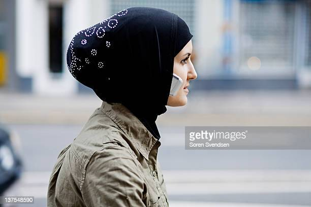 Woman with cell phone in headscarf