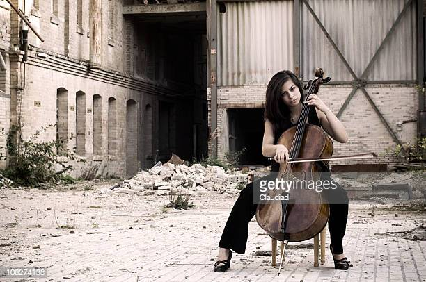 Woman with cello outdoors