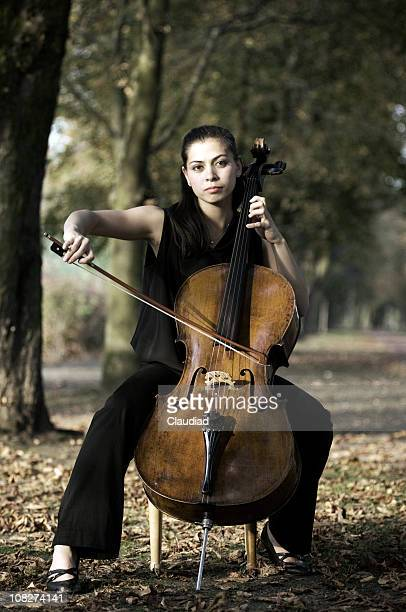 woman with cello outdoors - classical musician stock pictures, royalty-free photos & images