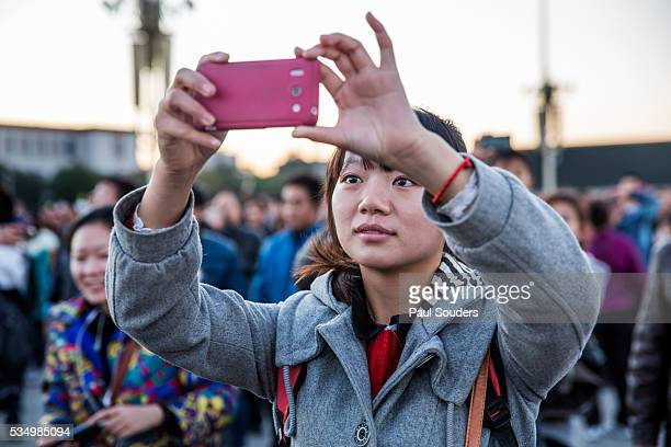 Woman with Cellphone Camera, Beijing, China