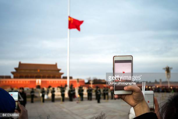 woman with cellphone camera, beijing, china - holding aloft stock pictures, royalty-free photos & images