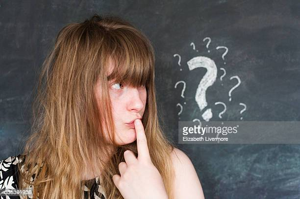 Woman with chalkboard question mark