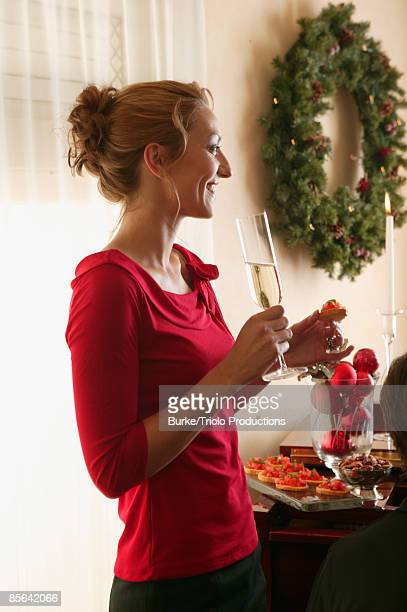 Woman with champagne and appetizers
