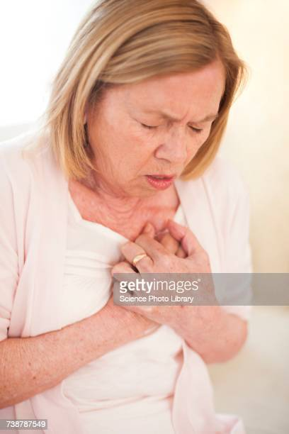 woman with chest pain - heart disease stock pictures, royalty-free photos & images