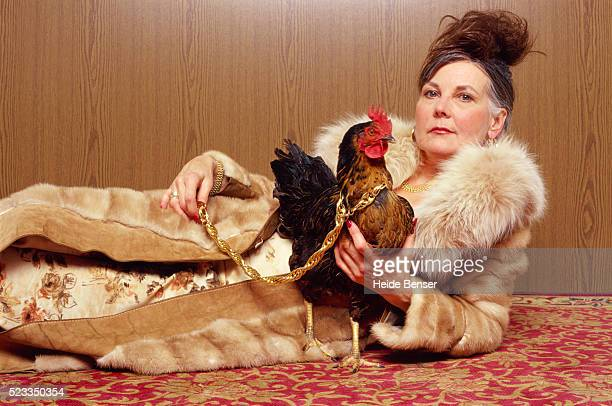 woman with chicken - bizarre stock pictures, royalty-free photos & images