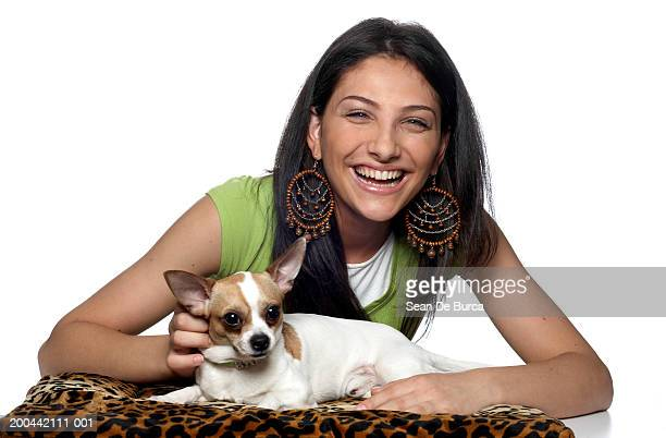 Woman with chihuahua on cushion, portrait
