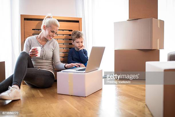 Woman with child in new apartment