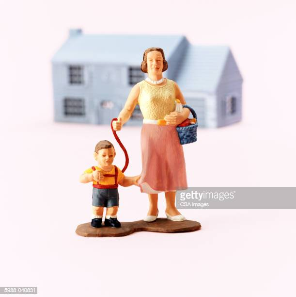 woman with child on leash - human representation stock pictures, royalty-free photos & images
