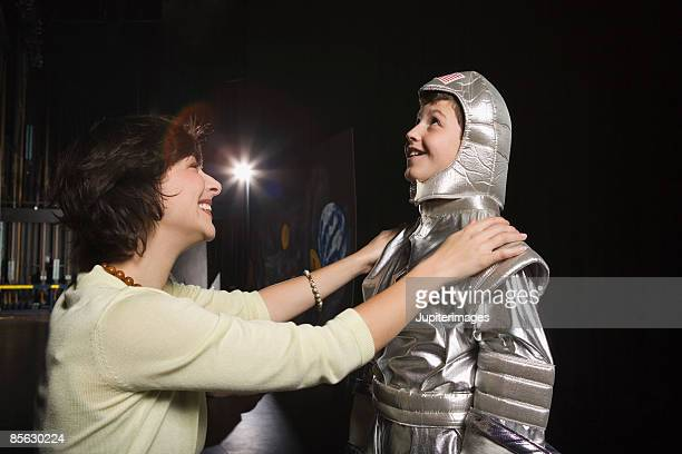 Woman with child wearing astronaut costume