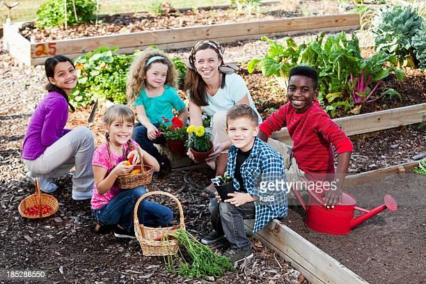 Woman with children in community garden