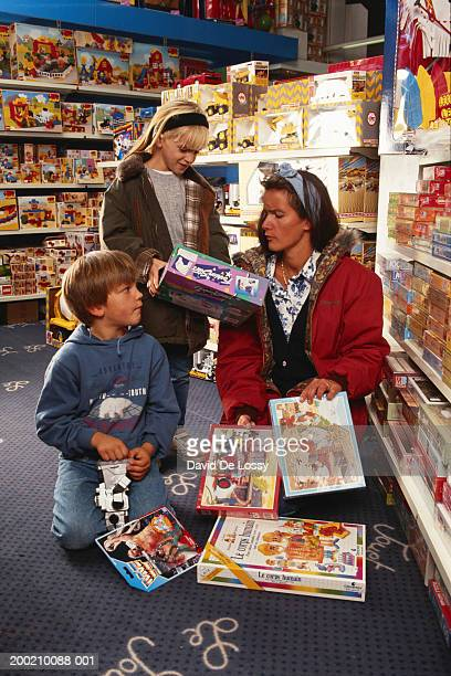 Woman with children in toy store