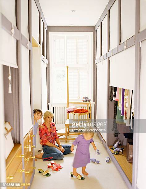 Woman with Children Playing in Master Closet