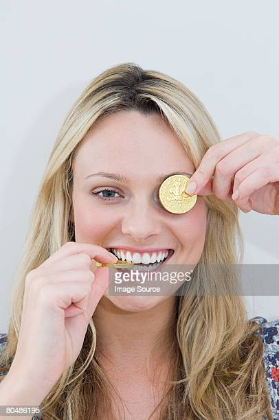 Woman with chocolate coins