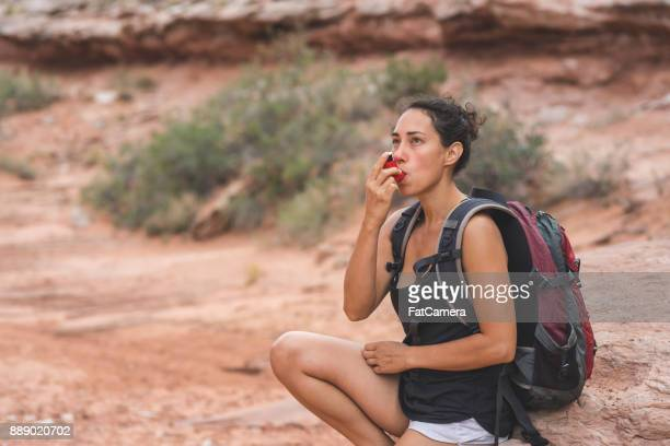 woman with chronic asthma hiking in desert - asthmatic stock photos and pictures