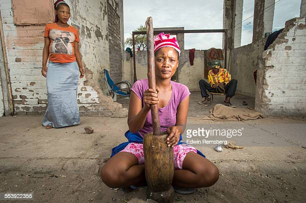 Woman with churning tools