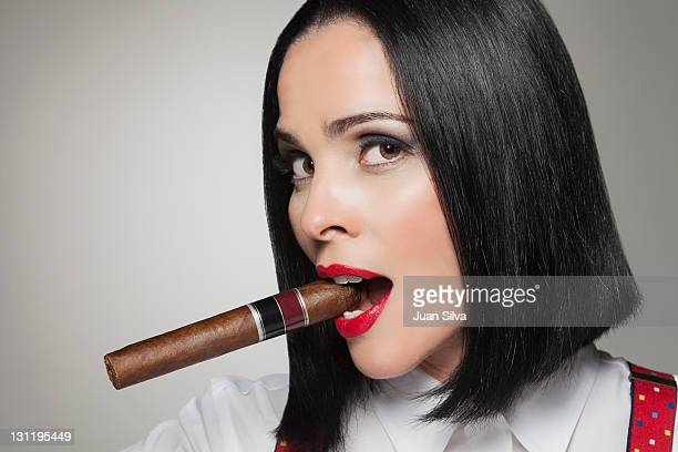 woman with cigar - beautiful women smoking cigars stock photos and pictures