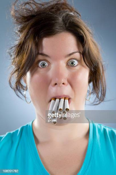 Woman with Cigarettes in Mouth