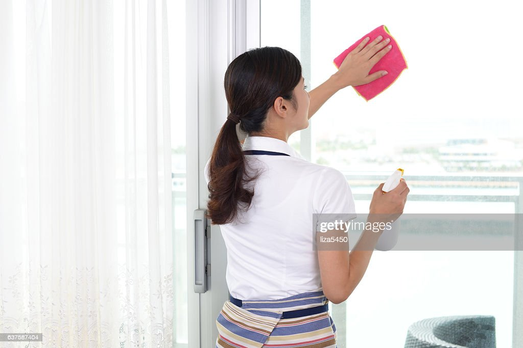 Woman with cleaning tools : Stock Photo